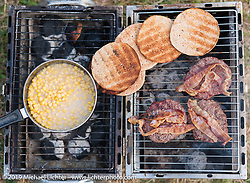 BBQ grill at the Buffalo Chip Campgrounds during the annual Sturgis Black Hills Motorcycle Rally. SD, USA. August 6, 2014.  Photography ©2014 Michael Lichter.
