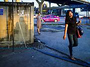 25 SEPTEMBER 2017 - RANGSIT, PATHUM THANI, THAILAND: People going into Bangkok walk into the Rangsit minivan station.       PHOTO BY JACK KURTZ