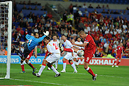 Steve Morison of Wales attempts to connect with the ball. Euro 2012 Qualifying match, Wales v Montenegro at the Cardiff City Stadium in Cardiff  on Friday 2nd Sept 2011. Pic By  Andrew Orchard, Andrew Orchard sports photography,