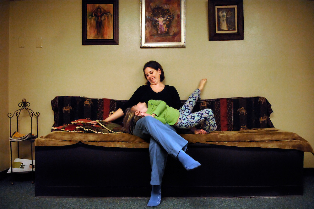 """It's break time on Monday morning. One class of toddlers is out the door, and Brenda Haynes, 34, sits on a long bench, her 4-year-old daughter, Margo, draped across her lap. Margo stretches out, one toe en pointe, basking in her mother's undivided attention.<br /> <br /> It was for Margo that Brenda left her job as a special education teacher four years ago. """"I knew I wanted to be with her,"""" Brenda says, """"and I knew I wanted more than one child."""" She also knew her growing family eventually would need more income.<br /> <br /> Brenda didn't want to return to full-time teaching: """"In the public schools, you're required to do so much paperwork there's little time to spend with the students. It's exhausting.""""<br /> <br /> The daughter and granddaughter of singers, Brenda looked for a way to combine her expertise in education and music with her need for a flexible schedule. After a lot of research, she chose the Kindermusik curriculum and became licensed while Margo was still an infant.<br /> <br /> Her first demonstration class drew three students - all signed up. Brenda now teaches 11 classes a week with 70 students at her studio and another 150 around Mid-Missouri.<br /> <br /> For Margo and 2-year-old Corwin, sharing their mother's attention can be a challenge. """"My daughter knows she can control whether I succeed or fail if she acts out,"""" Brenda says. Success is on Brenda's mind a lot these days. Her business isn't yet financially stable. She hopes to grow to 100 students in the next few years and recoup the investment she made in the early years.<br /> <br /> As for her investment in her children, that has already paid off. """"It's given us a lot of bonding moments. My daughter loves to sing,"""" Brenda says, and it continues the family's musical legacy.<br /> <br /> """"I hope they love music and will choose to make it a part of their lives."""""""