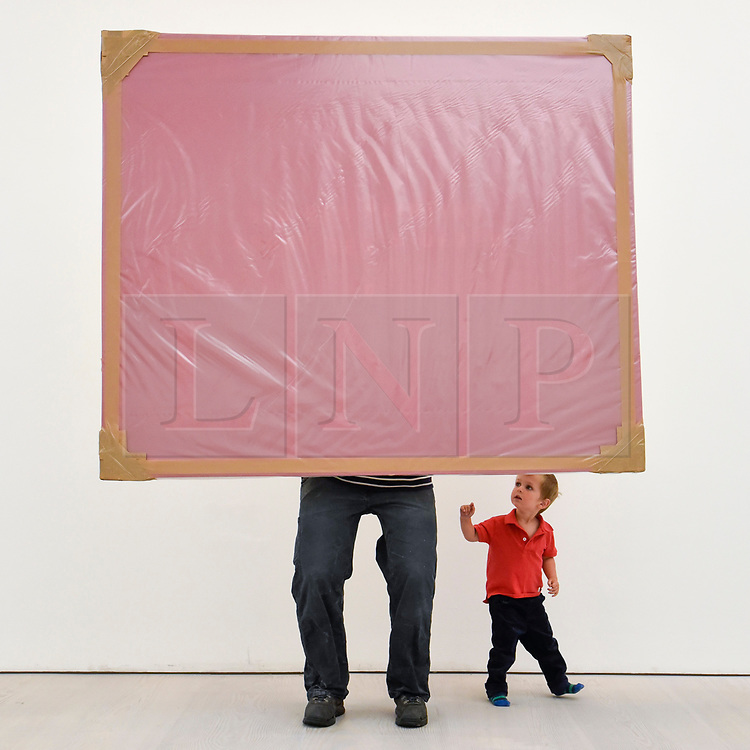 """© Licensed to London News Pictures. 27/09/2018. LONDON, UK. Emlyn Simmonds, aged two and a half, from Lewisham, views an installation called """"Cash Cow"""", 2012, by Jade Townsend.  Preview of """"Black Mirror"""", a major new exhibition featuring the work of 26 contemporary artists, at the Saatchi Gallery.  The show explores art's role in social satire and how political uncertainty has influenced art of recent years and runs 28 September to 13 January 2019.   Photo credit: Stephen Chung/LNP"""