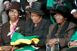 Walter Sisulu's widow Albertina looks down at the ANC flag that was presented to her by the honour gaurd after it was removed fromt he ANC stalwarts coffin. Shayne Robinson/SAPA.
