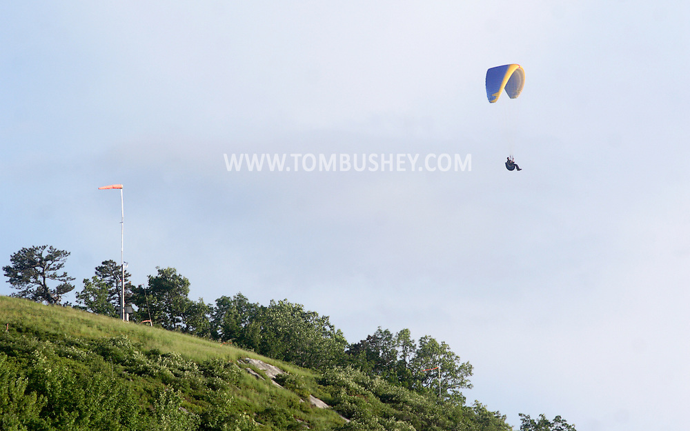 Ellenville, NY - A paraglider soars in the sky above the takeoff area on the Shawangunk Ridge about Ellenville on May 30, 2009.