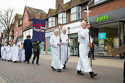 © Licensed to London News Pictures. 14/4/2016. Solihull, West Midlands, UK.  Easter Walk of Witness taking place in Solihull. Pictured, the procession makes it's way into Mell Square. All the churches of Solihull coming together. Starting at St Augustine's Church around two hundred people walked behind a wooden cross into Mell Square for readings and prayers before continuing the walk to St Alphege Church.  Photo credit: Dave Warren/LNP