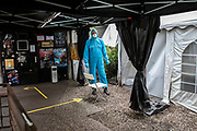 Medical personnel staff member at a covid-19 test station outside the Kitkat night club in Berlin, Germany, December 13, 2020. Berlin's world famous KitKatClub has initiated a fast covid-19 tests operation in its premises People are able to set an online appointment and arrive to have a covid antigen rapid test swab test in what was reported by local media outlet as the lowest price in the German capital. The club itself is closed since early 2020 due to the health restrictions imposed on cultural venues in Germany.