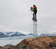 U. S. Geological Survey glaciologist Shad O'Neel services a time-lapse camera installed at Columbia Glacier, Alaska.