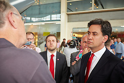 © Licensed to London News Pictures.  19/07/2014. Milton Keynes, UK. Labour leader ED MILIBAND speaks to shoppers during a visit to the Centre:MK shopping centre in Milton Keynes. Photo credit: Cliff Hide/LNP
