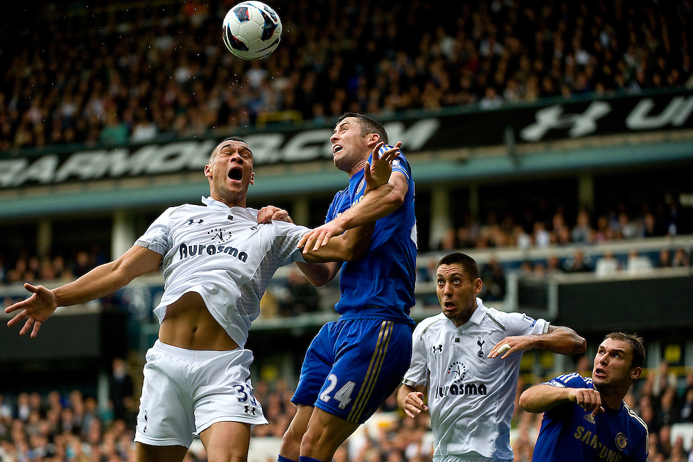 Chelsea defender Gary Cahill [cl] wins a header over Tottenham defender Steven Caulker [l] as Tottenham midfielder Clint Dempsey [cr] and Chelsea defender Branislav Ivanovic look on during Tottenham's home match to Chelsea at White Hart Lane. London October 20, 2012. Chelsea would come from behind to beat Tottenham 4-2.