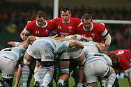The Welsh front row l to r Paul James, Matthew Rees and Gethin Jenkins pack down in a scrum against the Argentinians. Invesco perpetual series, Wales v Argentina at the Millennium Stadium in Cardiff on Sat 21st Nov 2009. pic by Andrew Orchard, Andrew Orchard sports photography,