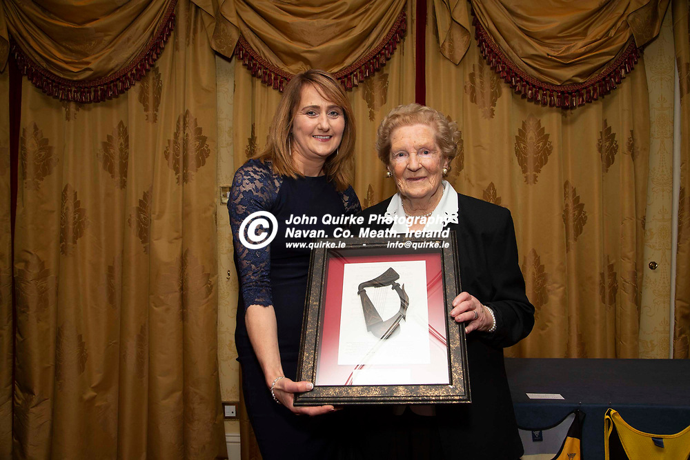 27/10/2019, Bohermeen Athletic Club 50th Anniversary celebration at the Ardboyne Hotel, Navan.<br /> Agnes Reilly presents an outstanding service award to current club president - Sheila Mallon<br /> Photo: David Mullen / www.quirke.ie ©John Quirke Photography, Unit 17, Blackcastle Shopping Cte. Navan. Co. Meath. 046-9079044 / 087-2579454.<br /> ISO: 400; Shutter: 1/200; Aperture: 6.3; <br /> File Size: 2.5MB