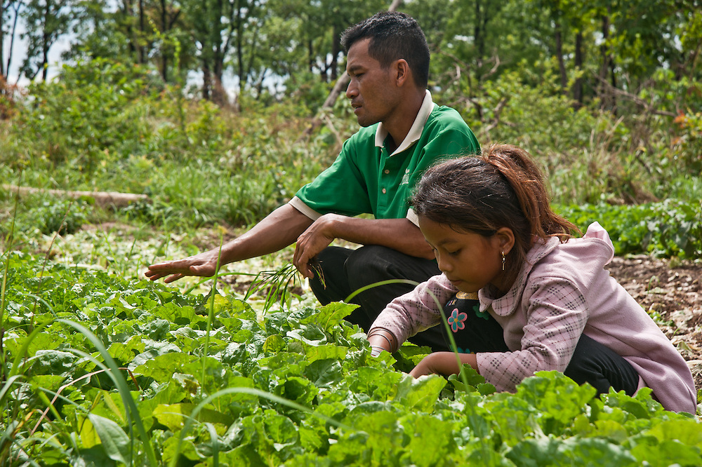 Chheu Teal Korng village:.Remarkable how much CWS has accomplished here in less than a.year, because they are working with such a willing and committed local committee. CWS is also supporting micro loans and training for fish, produce and.mushroom farming.