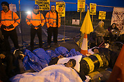 12 local activists locked themselves in specially made arm tubes to block the entrance to Quadrillas drill site in New Preston Road, July 03 2017, Lancashire, United Kingdom. The 13 activists included 3 councillors; Julie Brickles, Miranda Cox and Gina Dowding and Nick Danby, Martin Porter, Jeanette Porter,  Michelle Martin, Louise Robinson,<br /> Alana McCullough, Nick Sheldrick, Cath Robinson, Barbara Cookson, Dan Huxley-Blyth. The blockade is a repsonse to the emmidiate drilling for shale gas, fracking, by the fracking company Quadrilla. Lancashire voted against permitting fracking but was over ruled by the conservative central Government. All the activists have been active in the struggle against fracking for years but this is their first direct action of peacefull protesting. Fracking is a highly contested way of extracting gas, it is risky to extract and damaging to the environment and is banned in parts of Europe . Lancashire has in the past experienced earth quakes blamed on fracking.
