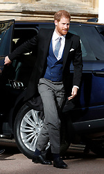 Prince Harry arrives for the wedding of Princess Eugenie to Jack Brooksbank at St George's Chapel in Windsor Castle.