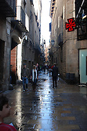 Street scene after a rain, gothic quarter, Barcelona, Spain
