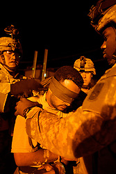 Members of the 1st Infantry, 17th Regiment, transport captured insurgent Imad Shaeb, also known as Adel, to the Iraqi Army battalion 222, Mosul, Iraq, Dec. 11, 2005. American troops are helping Iraqi forces secure the area in preparation for Iraq's first post-Saddam parliamentary elections. The western sector is home to Mosul's primarily Sunni population, which has been resistant to the American presence in Iraq.