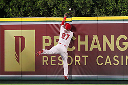 May 18, 2018 - Anaheim, CA, U.S. - ANAHEIM, CA - MAY 18: Mike Trout (27) of the Angels goes up high over the fence to make a catch and bring back a home run but looses the grip on the ball as he goes face first into the wall, the ball comes loose and falls over the fence for a home run by Wilson Ramos of the Rays during the major league baseball game between the Tampa Bay Rays and the Los Angeles Angels on May 18, 2018 at Angel Stadium of Anaheim in Anaheim, California. (Photo by Cliff Welch/Icon Sportswire) (Credit Image: © Cliff Welch/Icon SMI via ZUMA Press)