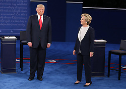 Donald Trump and Hillary Clinton take the stage at the start of the second debate between the Republican and Democratic presidential candidates on Sunday, October 9, 2016 at Washington University in St. Louis, Mo. Photo by Christian Gooden/St. Louis Post-Dispatch/TNS/ABACAPRESS.COM