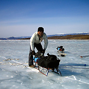 Justin prepares to trek across frozen Lake Baikal in Siberia, Russia from Olkhon Island (6th day). .They are a group of five people: Justin Jin (Chinese-British), Heleen van Geest (Dutch), Nastya and Misha Martynov (Russian) and their Russian guide Arkady. .They pulled their sledges 80 km across the world's deepest lake, taking a break on Olkhon Island. They slept two nights on the ice in -15c. .Baikal, the world's largest lake by volume, contains one-fifth of the earth's fresh water and plunges to a depth of 1,637 metres..The lake is frozen from November to April, allowing people to cross by cars and lorries.