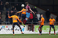 Scunthorpe United defender Cameron Burgess (21) and Oldham Athletic midfielder Kean Bryan (40) battles for possession during the EFL Sky Bet League 1 match between Scunthorpe United and Oldham Athletic at Glanford Park, Scunthorpe, England on 3 March 2018. Picture by Mick Atkins.