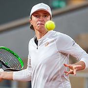 PARIS, FRANCE October 04.  Iga Swiatek of Poland in action against Simona Halep of Romania in the fourth round of the singles competition on Court Philippe-Chatrier during the French Open Tennis Tournament at Roland Garros on October 4th 2020 in Paris, France. (Photo by Tim Clayton/Corbis via Getty Images)