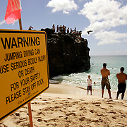Honolulu, HI, July 17, 2007: A large crop of rock provides perfect place to jump from into the water at Waimea Bay on the North Shore of Oahu in Hawaii. (Photograph by Todd Bigelow/Aurora)