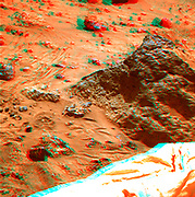 Mini Matterhorn is a 3/4 meter rock immediately east-southeast of the Mars Pathfinder lander. This view was produced by combining the 'Super Panorama' frames from the IMP camera.