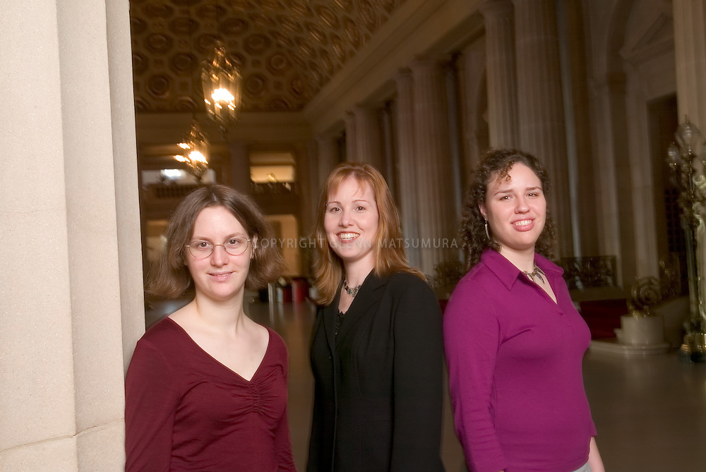 Marketing Director and Swarthmore alumni Jennifer Owen with interns Micaela Baranello (glasses) and Tori Martello (red top) in the lobby of the San Francisco Opera House.