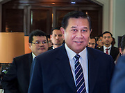 """29 MAY 2015 - BANGKOK, THAILAND: H.E. General TANASAK PATIMAPRAGORN, Deputy Prime Minister and Minister of Foreign Affairs of Thailand,  walks into a press conference at the """"Special Meeting on Irregular Migration in the Indian Ocean."""" Thailand organized and hosted the meeting at the Anantara Siam Hotel in Bangkok. The meeting brought together representatives from the 5 countries impacted by the boat people exodus: Thailand, Malaysia and Indonesia, which have all received boat people, and Myanmar (Burma) and Bangladesh, where they are coming from. Non-governmental organizations, like the International Organization for Migration (IOM) and UN High Commissioner for Refugees (UNHCR) as well as countries responding to the crisis, like the United States, also attended the meeting. A total of 22 organizations attended the one day conference.      PHOTO BY JACK KURTZ"""
