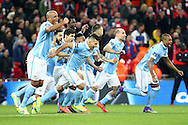 Manchester city players celebrate the win over Liverpool after penalty shoot out. Capital One Cup Final, Liverpool v Manchester City at Wembley stadium in London, England on Sunday 28th Feb 2016. pic by Chris Stading, Andrew Orchard sports photography.