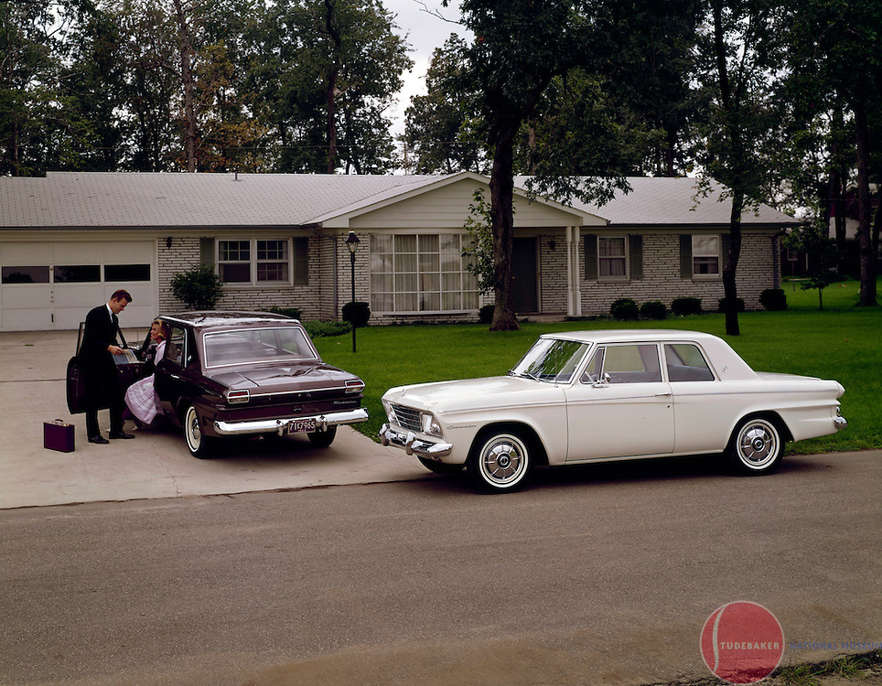 A pair of 1965 Studebaker Commander sedans are shown in this publicity shot.