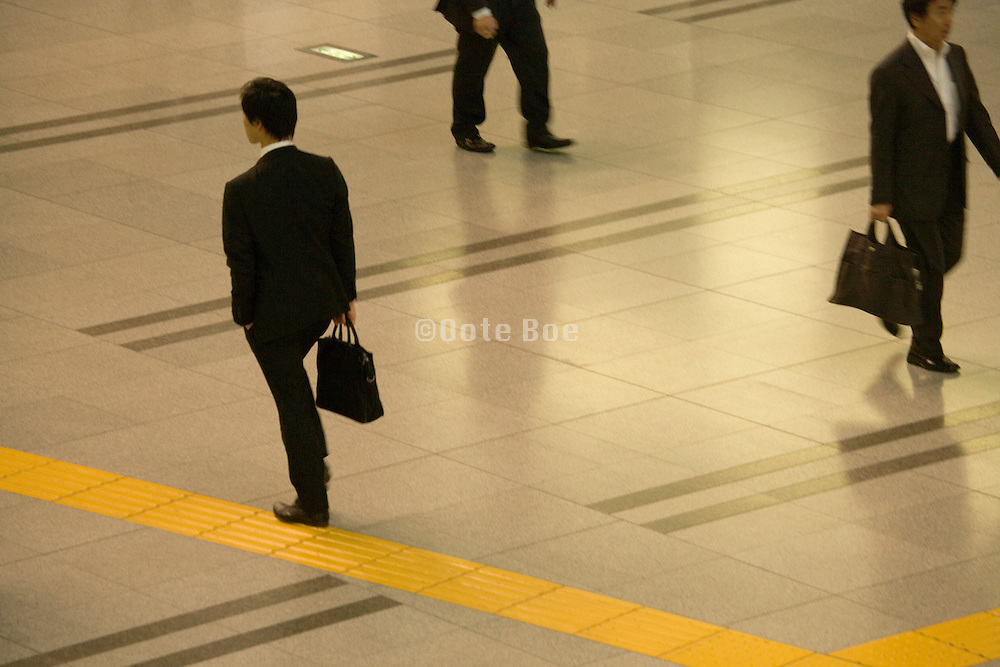 businessmen walking in the corridor of large office building