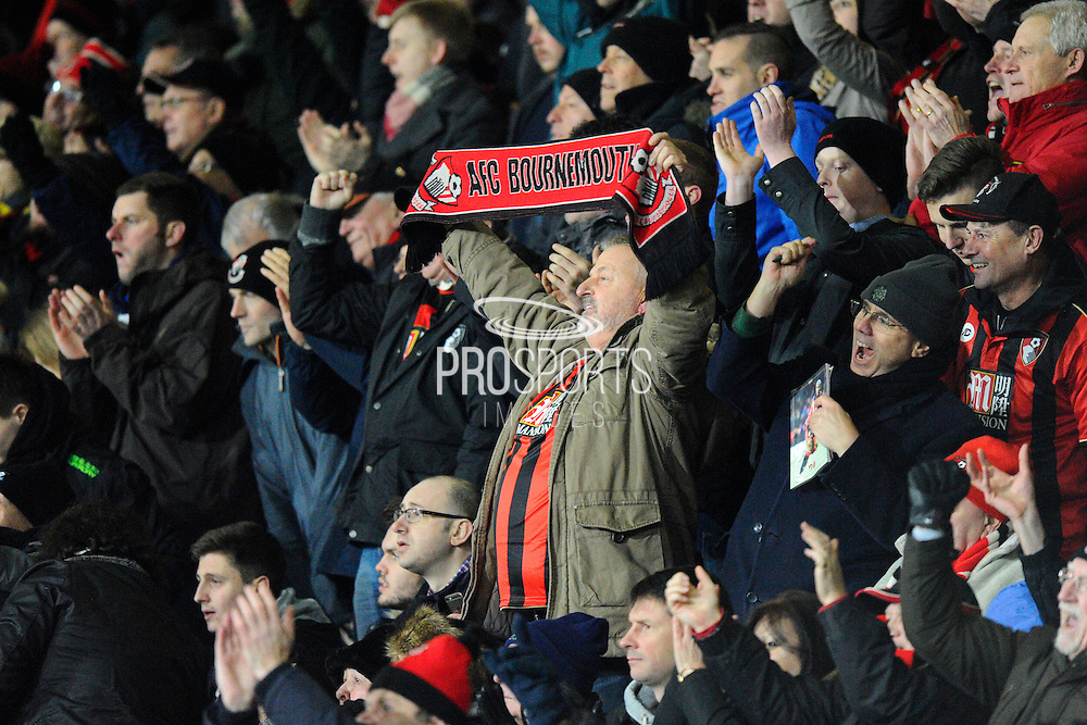 A Bournemouth fan holds his scalf above his head after Bournemouth takes the lead during the Premier League match between Bournemouth and Arsenal at the Vitality Stadium, Bournemouth, England on 3 January 2017. Photo by Graham Hunt.