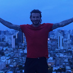 """David Beckham releases a photo on Instagram with the following caption: """"So happy to be in Thailand for the next few days and looking forward to chatting to you all on Facebook Live! \ud83c\uddf9\ud83c\udded\u2764\ufe0f Leave a question in the comments and I will be answering them live on Saturday 1 July. Link in bio."""". Photo Credit: Instagram *** No USA Distribution *** For Editorial Use Only *** Not to be Published in Books or Photo Books ***  Please note: Fees charged by the agency are for the agency's services only, and do not, nor are they intended to, convey to the user any ownership of Copyright or License in the material. The agency does not claim any ownership including but not limited to Copyright or License in the attached material. By publishing this material you expressly agree to indemnify and to hold the agency and its directors, shareholders and employees harmless from any loss, claims, damages, demands, expenses (including legal fees), or any causes of action or allegation against the agency arising out of or connected in any way with publication of the material."""