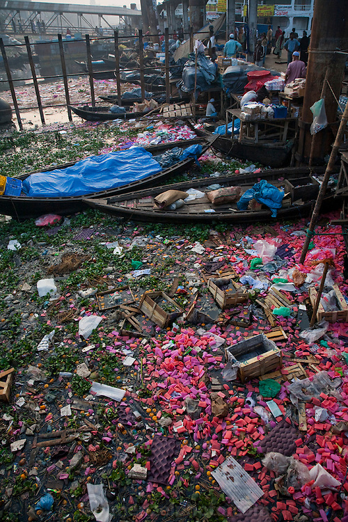 The Buriganga River in Dhaka, Bangladesh is heavily polluted with plastic and other non-biodegradable litter from fruit and vegetable markets at the Sadarghat docks.