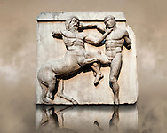 Sculpture of Lapiths and  Centaurs battling from the south east corner Metope of the Parthenon on the Acropolis of Athens no XXXII. Also known as the Elgin marbles. British Museum London. .<br /> <br /> If you prefer to buy from our ALAMY STOCK LIBRARY page at https://www.alamy.com/portfolio/paul-williams-funkystock/greco-roman-sculptures.html . Type -    Elgin    - into LOWER SEARCH WITHIN GALLERY box - Refine search by adding a subject, place, background colour, etc.<br /> <br /> Visit our ROMAN WORLD PHOTO COLLECTIONS for more photos to download or buy as wall art prints https://funkystock.photoshelter.com/gallery-collection/The-Romans-Art-Artefacts-Antiquities-Historic-Sites-Pictures-Images/C0000r2uLJJo9_s0