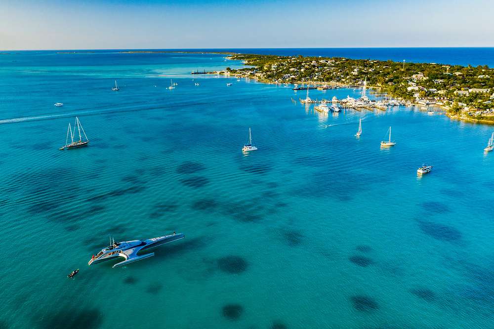 Yachts and sailboats moore in the lee of Harbour Island, Bahamas. Once home to thick densities of seagrass beds, now, due to anchors and moorings and pollution, only a few patches remain.