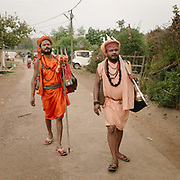 Hindu devotees of Shiva, going to ask for alms.<br />  Madhya Pradesh Province.