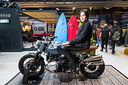 Model on the RnineT Scrambler in the BMW booth at Motor Bike Expo (MBE) bike show. Verona, Italy. Sunday, January 19, 2020. Photography ©2020 Michael Lichter.
