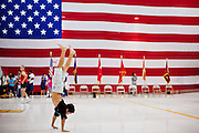 16 JUNE 2010 - PHOENIX, AZ: Bryce Suell,  9, from Phoenix, walks on his hands while waiting for his father to come home from Iraq at the 161st Air Refueling Wing hangar at Sky Harbor Airport in Phoenix Wednesday. Members of the 3666th Maintenance Company of the Arizona Army National Guard returned to Phoenix Wednesday after serving in Iraq (CQ).   PHOTO BY JACK KURTZ