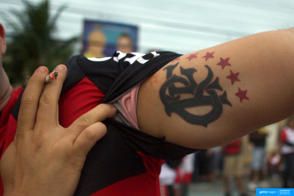 Flamengo fans display their tattoo's before their teams match against Palmeiras in the Futebol Brasileirao  League match at Estadio Olímpico Joao Havelange, Rio de Janeiro, Palmeiras won the match 3-1. Rio de Janeiro,  Brazil. 25th September 2010. Photo Tim Clayton