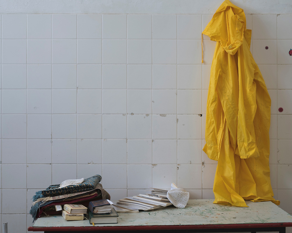 A rain coat and copies of the Quran in a building in the closed down refugee camp at the Port of Lakki. <br /> <br /> The camp was opened by volunteers in the summer of 2015 and later that year UNHCR and MSF expanded it and provided additional tents, toilets and other facilities. The camp was closed soon after the opening of a 'Hotspot' (EU-run migrant's reception centres) camp in Lepida in February 2016