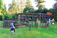 Old Westbury, New York, U.S. June 23, 2021. Children play and watch G gauge model trains travel on more than 220 feet of tracks during the Old Westbury Gardens opening reception for its outdoor Great Pine Railway exhibit, which runs until September 6.
