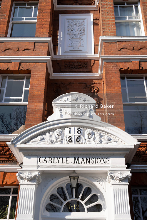 """An exterior of Carlyle Mansions on Cheyne Walk in Chelsea, on 8th March 2021, in London, England. Carlyle Mansions is a block of flats located on Cheyne Walk, in the Chelsea area of London, England. Built in 1886, it was named after Scottish historian, satirical writer, essayist, translator, philosopher, mathematician, and teacher, Thomas Carlyle, himself a resident of Chelsea for much of his life. Carlyle Mansions is nicknamed the """"Writers' Block"""", as it has been home to Henry James, Erskine Childers, T. S. Eliot, Somerset Maugham, Ian Fleming and other noted authors."""