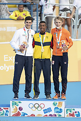 BUENOS AIRES, Oct. 9, 2018  Gold medalist Jhony Andres Angulo Reina (C) of Colombia, silver medalist Vincenzo Maiorca (L) of Italy and bronze medalist Merijn Scheperkamp of the Netherlands pose for photograph after the awarding ceremony of the men's combined of the roller speed skating event at the 2018 Summer Youth Olympic Games in Buenos Aires, Argentina on Oct. 8, 2018. (Credit Image: © Li Ming/Xinhua via ZUMA Wire)