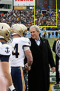 6 Dec 2008: President George W Bush greets a player before the coin toss of the Army / Navy game December 6th, 2008. At Lincoln Financial Field in Philadelphia, Pennsylvania.
