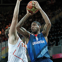 02 August 2012: Great Britain Drew Sullivan looks to pass the ball during 79-78 Team Spain victory over Team Great Britain, during the men's basketball preliminary, at the Basketball Arena, in London, Great Britain.