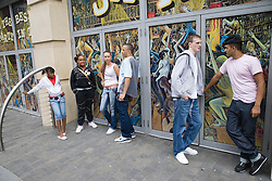 Multiracial group of teenagers hanging around town,