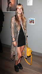 OLYMPIA CAMPBELL at Harper's Bazaar & Viva Model Management London opening of a Self-Portraits exhibition at the Moretti Galery, Ryder Street, London on 3rd September 2013.