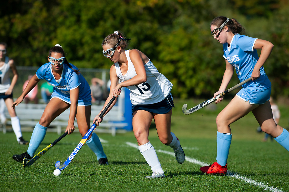 MMU's Ava Stotz (13) runs down the field with the ball during the high school girls field hockey game between the South Burlington Wolves and the Mount Mansfield Cougars at MMU High School on Thursday afternoon September 19, 2019 in Jericho, Vermont. (BRIAN JENKINS/for the FREE PRESS)