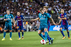 August 13, 2017 - Barcelona, Catalonia, Spain - Real Madrid midfielder KROOS competes with FC Barcelona midfielder I. RAKITIC for the ball during the Spanish Super Cup Final 1st leg between FC Barcelona and Real Madrid at the Camp Nou stadium in Barcelona (Credit Image: © Matthias Oesterle via ZUMA Wire)